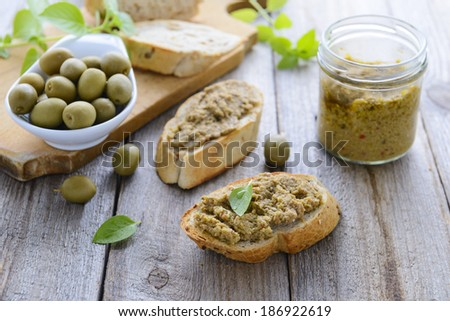 Two sandwiches with  pate of green olives - stock photo