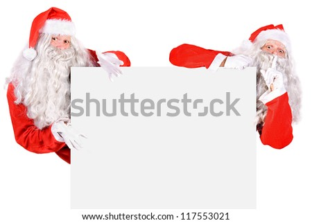 Two Santa Claus holding a blank sign isolated on white background