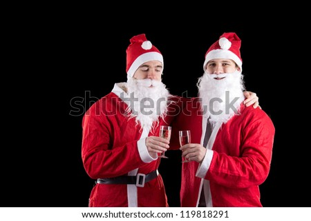 Two santa claus with champagne - stock photo
