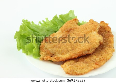 Two schnitzels on the white plate - stock photo