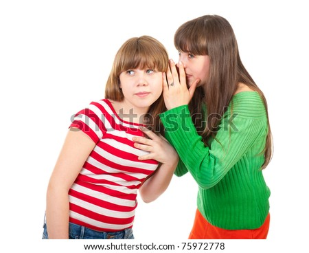 Two school girls whisper about handsome guy - stock photo