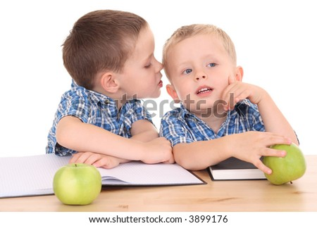 two schoolboys at desk isolated on white - stock photo