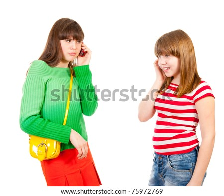 Two schoolgirls calling by the mobile phones isolated - stock photo