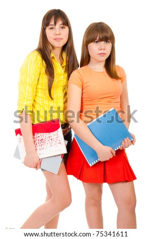 Two schoolgirls teenagers with notebooks isolated on white - stock photo