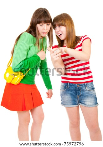 Two schoolgirls watching something in the mobile phone isolated - stock photo