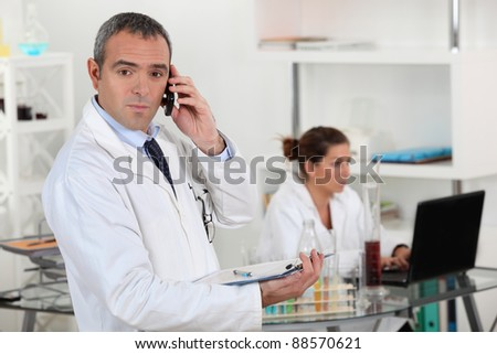 Two scientists in a laboratory. - stock photo