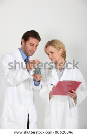Two scientists in laboratory - stock photo