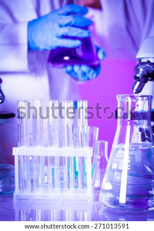 Two scientists in the chemical laboratory are doing experiments - stock photo