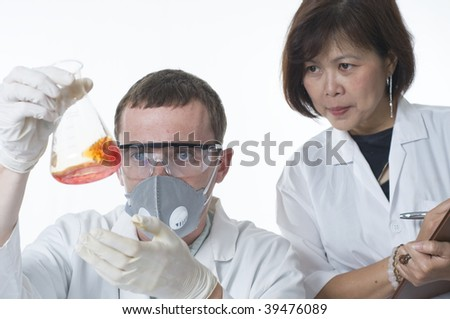 Two scientists working in a laboratory together - stock photo