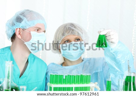 two scientists working in chemistry laboratory - stock photo