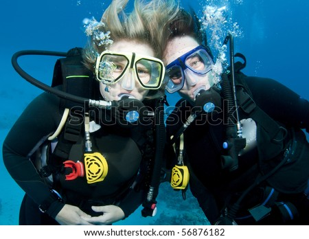 two scuba divers - stock photo