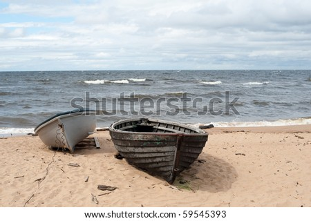 Two sea boats on the sea shore - stock photo