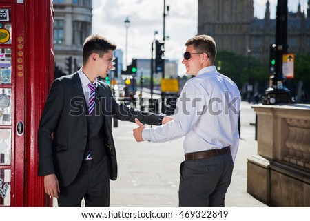 Two second in suits, businessmen met on the streets of London