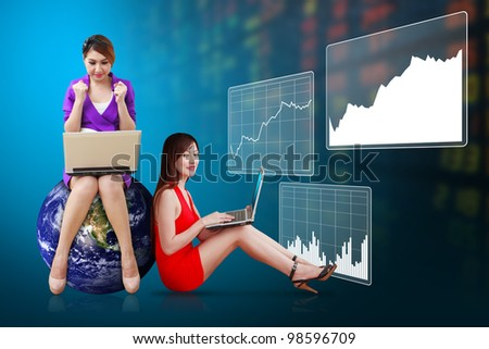 Two secretaries present the stock exchange graph report : Elements of this image furnished by NASA