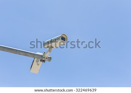 Two security camera on blue sky background