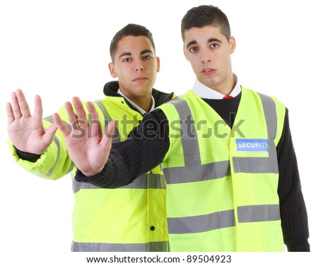 Two security guards with their hands out