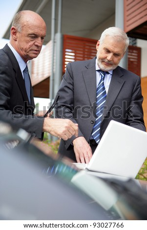 Two senior businessmen on house call - stock photo