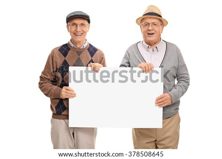 Two senior gentlemen holding a blank signboard and looking at the camera isolated on white background