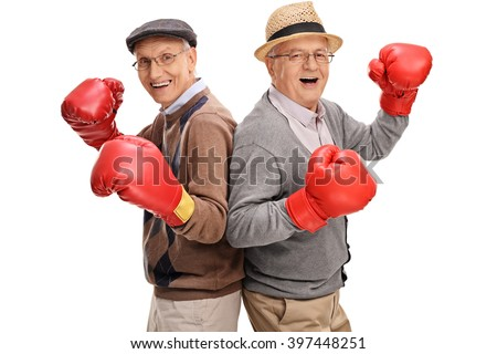 Two senior gentlemen posing together with boxing gloves isolated on white background - stock photo
