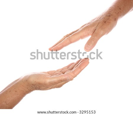 Two senior hands reaching towards each other, one as gesture for seeking help and the other as offering. - stock photo