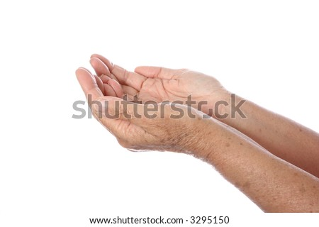 Two senior's hands cupped together, facing upwards as gesture of seeking or offering to the concept of help and thankfulness. Isolated on white. - stock photo