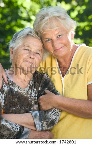 Two senior women hugging each other