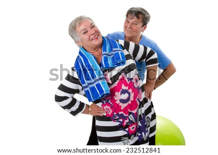 Two senior women making exercises with a fitness ball - stock photo