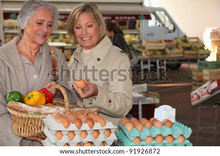 two senior women shopping on the market - stock photo