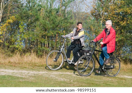 Two seniors on a bicycle trip during summer