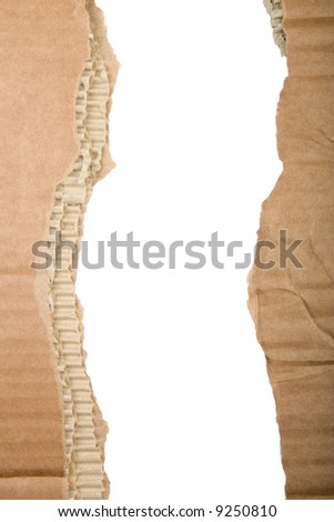 Two separate strips of ripped brown cardboard - stock photo
