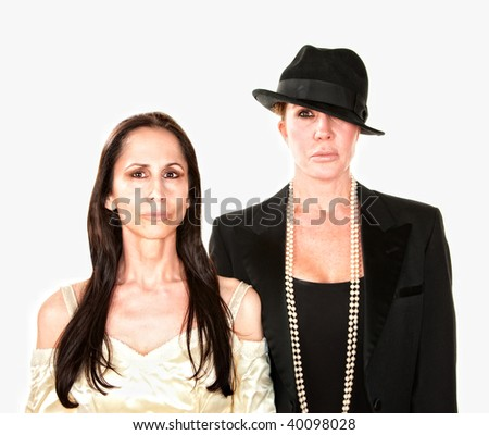 Two serious adult women dressed as bride and groom - stock photo