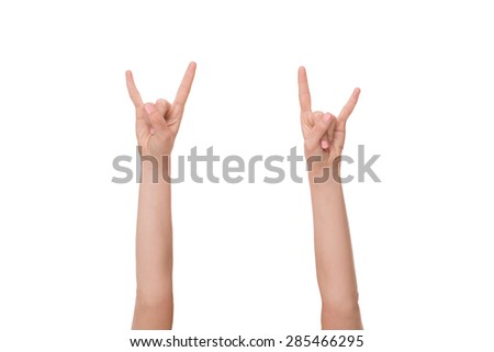 Two serious hands in the air showing importance of business strategy. Pretty blonde on white background. - stock photo