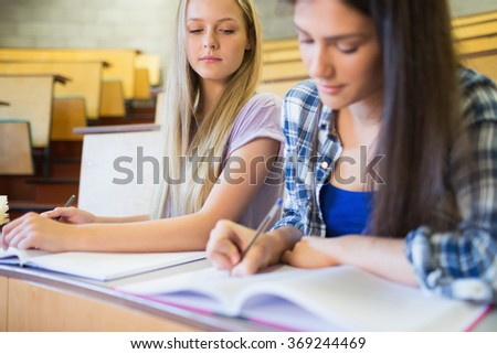 Two serious students working together in university - stock photo