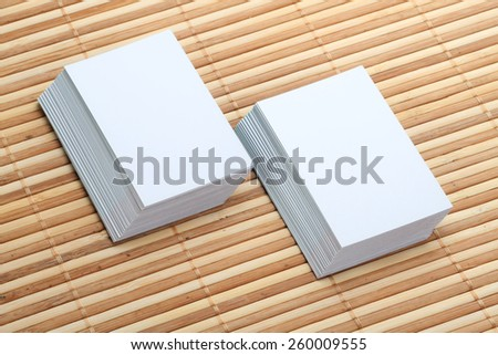Two Set of Blank Business Card Mockup on Wooden Background - stock photo