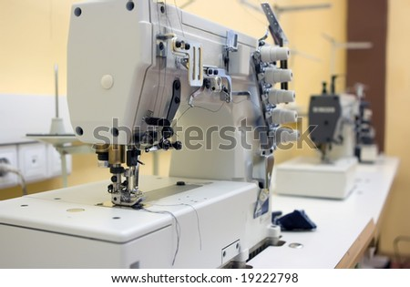 Two sewing machine on a table - stock photo