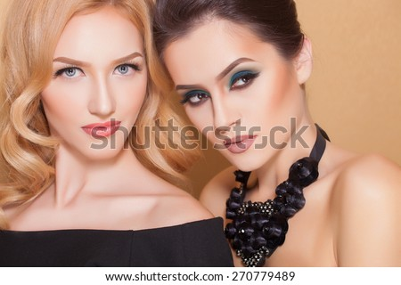 Two sexy and fashionable women with beautiful makeup, closeup shoot
