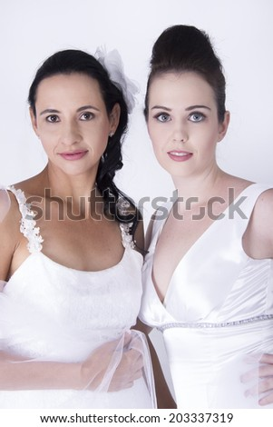 Two Sexy Brides wear Beautiful wedding gowns - stock photo
