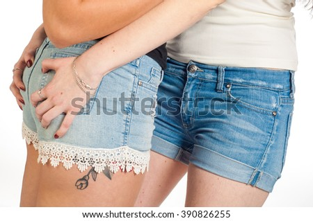 Two sexy female buttocks. Sexy woman body in jeans shorts.  The model is back. Great ass. ХХХ - stock photo