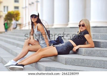 Two sexy girlfriends outdoor fashion portrait