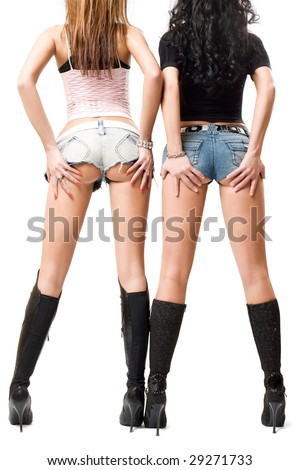 two sexy girls posing, isolated over white background - stock photo