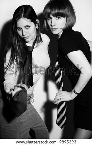 Two sexy girls wearing ties - stock photo