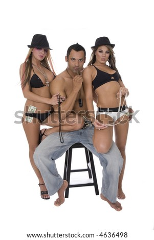 Two sexy girls with money and hot guy - stock photo