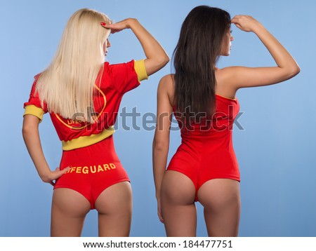 Two sexy lifeguards women - stock photo