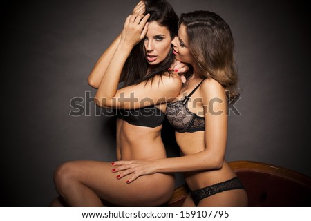 Two sexy lingerie women hugging - stock photo