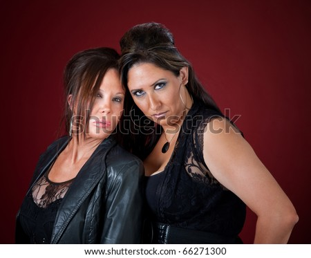 Two sexy middle-aged women in black pouting - stock photo