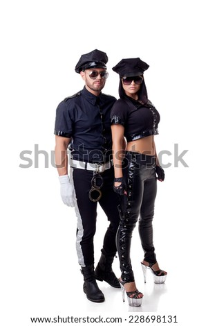 Two sexy strippers dressed in police costume - stock photo