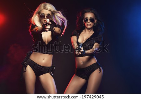 Two sexy woman like police woman - stock photo