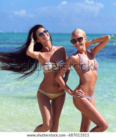 Two sexy women in a beach