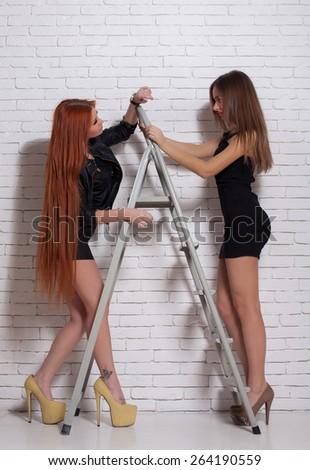 Two sexy women wearing mini skirts - stock photo