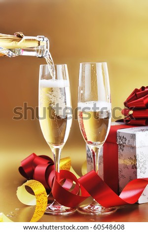 two shampagne glasses on celebratory table - stock photo